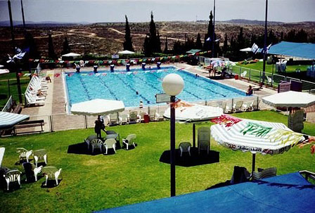 Swimming pool in illegal settlement.